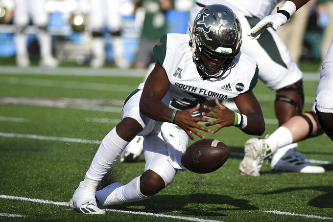South Florida quarterback Jordan McCloud recovers a fumble during the first half of an NCAA college football game against Houston , Saturday, Nov. 14, 2020, in Houston. (AP Photo/Eric Christian Smith)