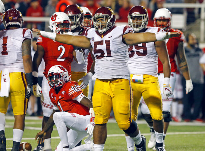 Southern California defensive lineman Marlon Tuipulotu (51) celebrates after sacking Utah quarterback Tyler Huntley (1) in the first half during an NCAA college football game Saturday, Oct. 20, 2018, in Salt Lake City. (AP Photo/Rick Bowmer)