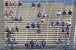 Fans sit in spread out groups as they watch the IndyCar Series auto race Friday, July 17, 2020, at Iowa Speedway in Newton, Iowa. (AP Photo/Charlie Neibergall)