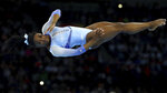 FILE- In this Oct. 5, 2019, file photo, Simone Biles, of the United States, performs on the floor during qualifying sessions for the Gymnastics World Championships in Stuttgart, Germany. (AP Photo/Matthias Schrader)