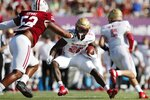 Boston College running back Alec Sinkfield (26) carries the ball as Massachusetts defensive lineman Uchenna Ezewike (52) defends during the first half of an NCAA college football game, Saturday, Sept. 11, 2021, in Amherst, Mass. (AP Photo/Michael Dwyer)