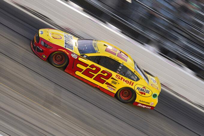 Joey Logano races in a NASCAR Cup Series auto race Sunday, Sept. 5, 2021, in Darlington, S.C. (AP Photo/John Amis)