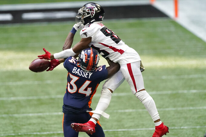 Atlanta Falcons wide receiver Russell Gage (83) misses the catch against Denver Broncos defensive back Essang Bassey (34) during the second half of an NFL football game, Sunday, Nov. 8, 2020, in Atlanta. (AP Photo/John Bazemore)