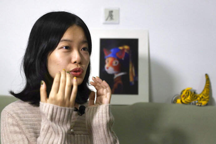 FILE - In this Jan. 16, 2019, file photo, screenwriter Zhou Xiaoxuan speaks during an interview with the Associated Press at her home in Beijing, China, detailing her involvement in China's #MeToo movement. A high profile case of sexual harassment in China's #MeToo movement involving a well-known Chinese state TV host will be tried in court Wednesday, Dec. 2, 2020 in Beijing after pending for more than two years. (AP Photo/Ng Han Guan, File)