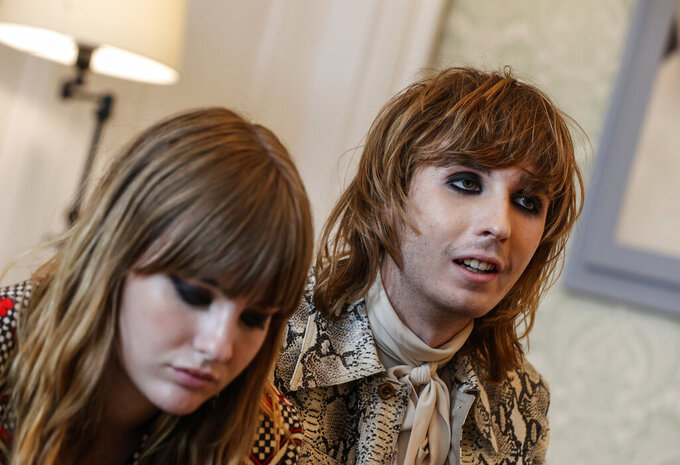 Bass player Victoria De Angelis, left, and guitarist Thomas Raggi, of the Italian band Maneskin, winners of the Eurovision Song Contest in May, attend an interview with the Associated Press at a hotel in Rome, Tuesday, July 27, 2021. (AP Photo/Riccardo De Luca)