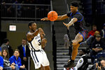 DePaul forward Romeo Weems, right, defends against Butler guard Kamar Baldwin (3) during the first half of an NCAA college basketball game Saturday, Jan. 18, 2020, in Chicago. (AP Photo/Matt Marton)