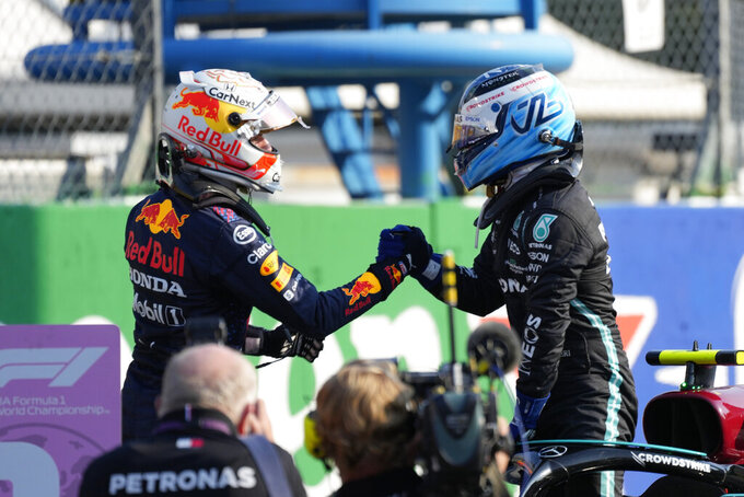 Mercedes driver Valtteri Bottas of Finland, the winner, right, is congratulated by runnerup Red Bull driver Max Verstappen of the Netherlands the Sprint Race qualifying session at the Monza racetrack, in Monza, Italy , Saturday, Sept.11, 2021. The Formula one race will be held on Sunday. (AP Photo/Luca Bruno)