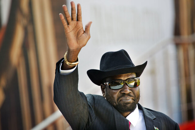 FILE - In this Saturday, May 25, 2019 file photo, South Sudan's President Salva Kiir arrives for the swearing-in ceremony of Cyril Ramaphosa at Loftus Versfeld stadium in Pretoria, South Africa. A new report made public in Nov. 2019 says South Sudan's National Security Service has recruited a force of 10,000 fighters in President Salva Kiir's ethnic stronghold, in apparent breach of the terms of the country's peace deal. (AP Photo/Jerome Delay, File)