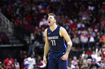Dallas Mavericks' Luka Doncic reacts after a teammate's 3-pointer against the Houston Rockets during the second half of an NBA basketball game Sunday, Nov. 24, 2019, in Houston. The Mavericks won 137-123. (AP Photo/David J. Phillip)