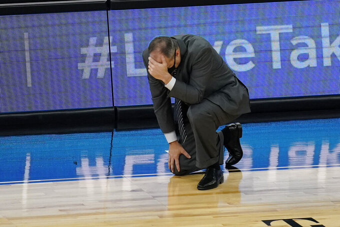 California head coach Mark Fox reacts after a play against Stanford during the second half of an NCAA college basketball game in the first round of the Pac-12 men's tournament Wednesday, March 10, 2021, in Las Vegas. (AP Photo/John Locher)
