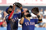 Texas Rangers shortstop Elvis Andrus, left, and second baseman Rougned Odor settle under a popout by New York Yankees' Clint Frazier during the fifth inning of a baseball game Monday, Sept. 2, 2019, in New York. (AP Photo/Adam Hunger)