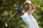 Brooks Koepka hits from the tee on the third hole during second-round play in the Tour Championship golf tournament at East Lake Golf Club, Friday, Sept. 3, 2021, in Atlanta. (AP Photo/Brynn Anderson)