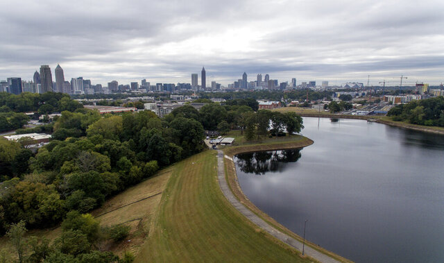 FILE - In this Oct. 15, 2019, file photo, reservoir No. 1, a 180 million-gallon water supply that has been out of service much of the past few decades, sits against the backdrop of the city skyline in Atlanta. U.S. Sen. Kirsten Gillibrand, D-N.Y., is proposing Tuesday, Dec. 17, 2019, to boost federal efforts to fortify the nation's dams following an Associated Press investigation that found scores of potentially troubling dams around the country.  (AP Photo/David Goldman, File)