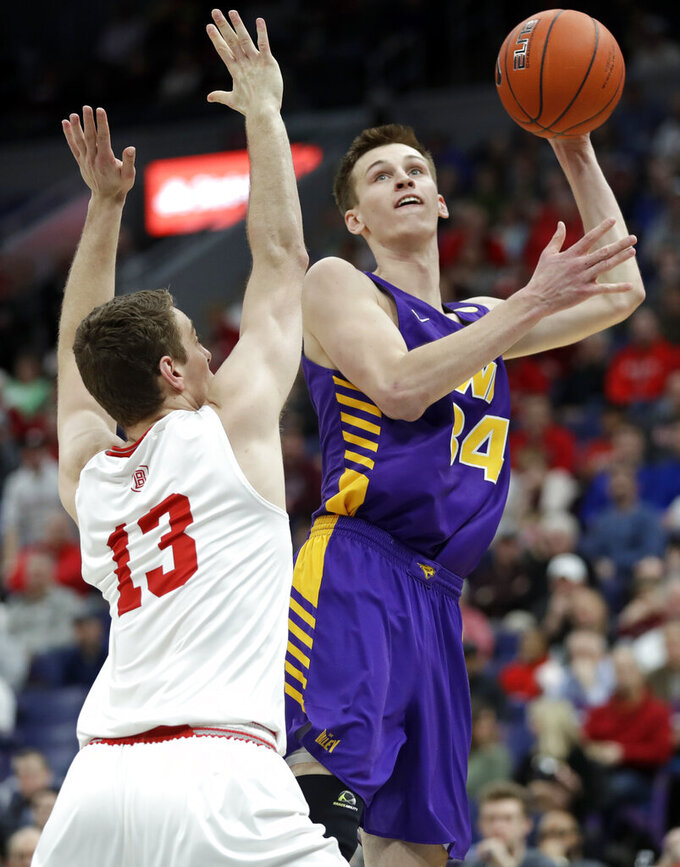 Northern Iowa's Luke McDonnell (34) shoots over Bradley's Luuk van Bree (13) during the first half of an NCAA college basketball game in the championship of the Missouri Valley Conference tournament, Sunday, March 10, 2019, in St. Louis. (AP Photo/Jeff Roberson)