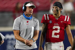 Mississippi head coach Lane Kiffin confers with quarterback Matt Corral (2) during the second half of the team's NCAA college football game against Tulane on Saturday, Sept. 18, 2021, in Oxford, Miss. Mississippi won 61-21. (AP Photo/Rogelio V. Solis)
