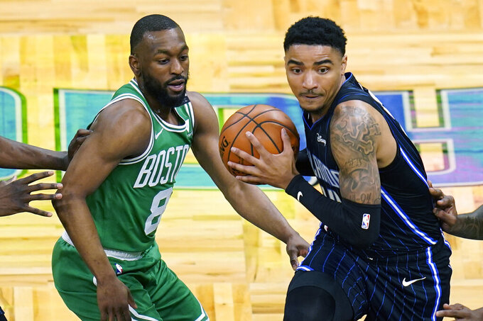 Orlando Magic guard Gary Harris, right, makes a move to get past Boston Celtics guard Kemba Walker (8) during the first half of an NBA basketball game, Wednesday, May 5, 2021, in Orlando, Fla. (AP Photo/John Raoux)