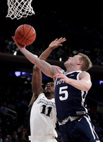 Butler guard Paul Jorgensen (5) goes up for a shot against Providence guard Alpha Diallo (11) during the second half of an NCAA college basketball game in the Big East men's tournament Wednesday, March 13, 2019, in New York. Providence won 80-57. (AP Photo/Julio Cortez)