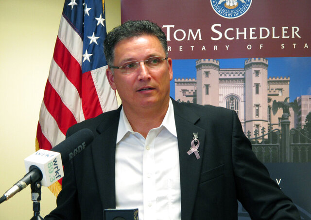 FILE - In this July 12, 2017 file photo, former state Rep. John Schroder, R-Covington, speaks after completing his paperwork to run for state treasurer, in Baton Rouge, La. Louisiana's State Treasurer Schroder says some small businesses harmed by the coronavirus pandemic should start seeing grants from a $300 million federally financed program as soon as next month. The money is part of $1.8 billion in direct congressional relief that Louisiana received to respond to COVID-19. Schroder told lawmakers Monday, June 22, 2020, that he hopes to have distributed all of the aid over a few months.  (AP Photo/Melinda Deslatte, File)
