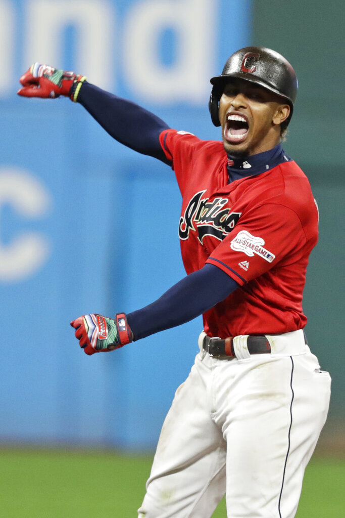 Cleveland Indians' Francisco Lindor reacts after hitting an RBI double in the ninth inning of the team's baseball game against the Boston Red Sox, Tuesday, Aug. 13, 2019, in Cleveland. (AP Photo/Tony Dejak)
