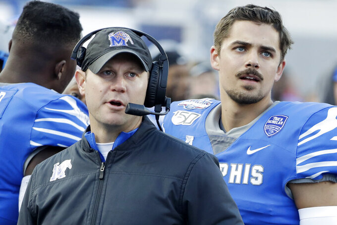 In this Dec. 7, 2019 photo, Memphis deputy head coach Ryan Silverfield, left, watches a replay on the scoreboard with quarterback Brady White, right, during an NCAA college football game between Memphis and Cincinnati for the American Athletic Conference championship in Memphis, Tenn. Silverfield was named head coach Friday, Dec. 13, after after Mike Norvell accepted the head coach position at Florida State. (AP Photo/Mark Humphrey)