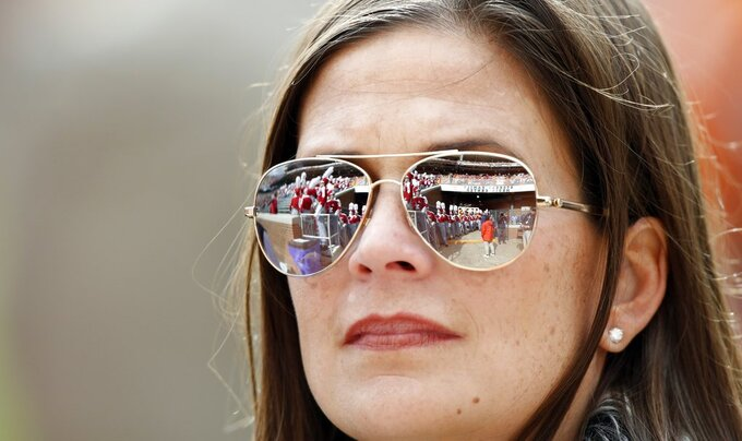 The Alabama band is reflected in the glasses of a fan before an NCAA college football game against Tennessee, Saturday, Oct. 20, 2018, in Knoxville, Tenn. (AP Photo/Wade Payne)