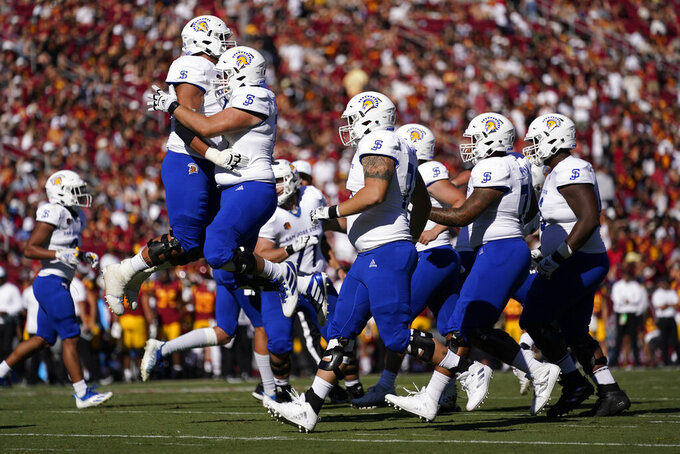 San Jose State players celebrate after scoring a touchdown dsecond half of an NCAA college football game against Southern California Saturday, Sept. 4, 2021, in Los Angeles. (AP Photo/Ashley Landis)