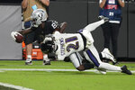 Las Vegas Raiders wide receiver Bryan Edwards (89) dives for yardage against Baltimore Ravens cornerback Brandon Stephens (21) during overtime in an NFL football game, Monday, Sept. 13, 2021, in Las Vegas. (AP Photo/Rick Scuteri)