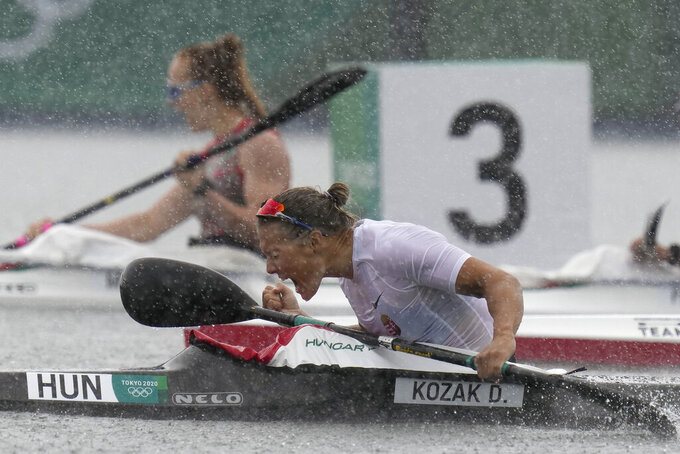 Danuta Kozak, of Hungary, reacts after her team finished first in the women's kayak four 500m final at the 2020 Summer Olympics, Saturday, Aug. 7, 2021, in Tokyo, Japan. (AP Photo/Kirsty Wigglesworth)