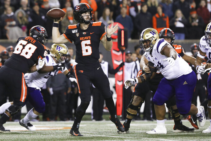 Oregon State quarterback Jake Luton (6) looks for an open receiver during the first half of the team's NCAA college football game against Washington in Corvallis, Ore., Friday, Nov. 8, 2019. (AP Photo/Amanda Loman)