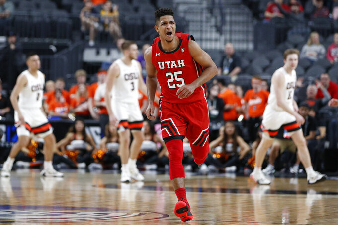 Utah's Alfonso Plummer (25) reacts after making a 3-point shot against Oregon State during the first half of an NCAA college basketball game in the first round of the Pac-12 men's tournament Wednesday, March 11, 2020, in Las Vegas. (AP Photo/John Locher)