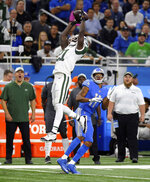 New York Jets defensive back Morris Claiborne (21) intercepts a pass intended for Detroit Lions wide receiver Marvin Jones (11) during the first half of an NFL football game in Detroit, Monday, Sept. 10, 2018. (AP Photo/Jose Juarez)