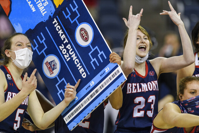 Belmont players celebrate after defeating UT-Martin in an NCAA college basketball game in the championship of the Ohio Valley Conference tournament at the Ford Center in Evansville, Ind., Saturday, March 6, 2021. (Sam Owens/Evansville Courier & Press via AP)