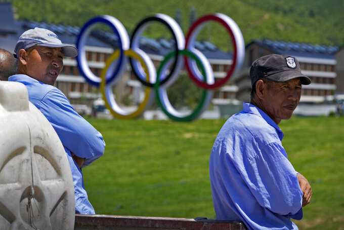 Workers take their break near the Olympics Village for Beijing 2022 Olympic and Paralympic Winter Games and Paralympic Winter Games, during a media tour in Zhangjiakou in northwestern China's Hebei province on Wednesday, July 14, 2021. (AP Photo/Andy Wong)