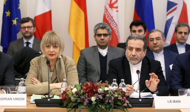 The European Union's political director Helga Schmid and Iran's deputy Foreign Minister Abbas Araghchi, from left, wait for a bilateral meeting as part of the closed-door nuclear talks with Iran in Vienna, Austria, Friday, Dec. 6, 2019. (AP Photo/Ronald Zak)