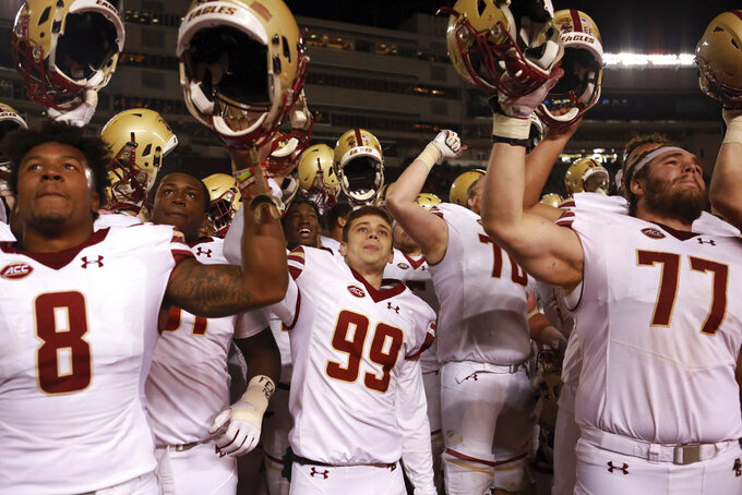 Boston College place kicker Colton Lichtenberg (99) center and his teammates celebrate winning the Virginia Tech - Boston College football game 31-21 in Blacksburg Va. Saturday November 3 2018. (Matt Gentry/The Roanoke Times via AP)