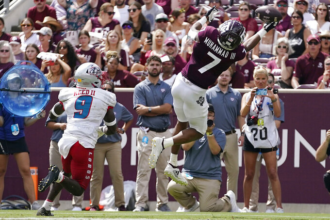 Texas A&M wide receiver Moose Muhammad III (7) makes a one-handed catch for a touchdown in front of New Mexico safety Jerrick Reed II (9) during the second half of an NCAA college football game on Saturday, Sept. 18, 2021, in College Station, Texas. (AP Photo/Sam Craft)