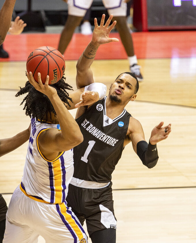 St. Bonaventure guard Dominick Welch (1) guards LSU forward Trendon Watford (2) during the second half of a first round game in the NCAA men's college basketball tournament, Saturday, March 20, 2021, at Assembly Hall in Bloomington, Ind. (AP Photo/Doug McSchooler)