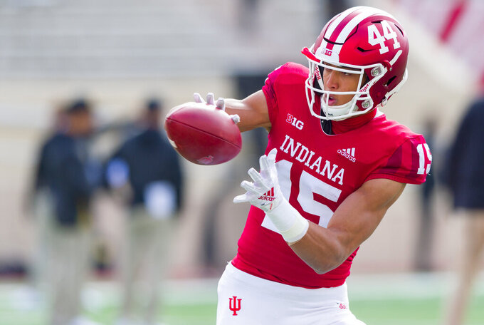 FILE - In this Saturday, Oct. 13, 2018, file photo, Indiana wide receiver Nick Westbrook (15) warms up before an NCAA college football game in Bloomington, Ind. Westbrook senses this season will be different at Indiana.  He hears coaches debating how to use their suddenly deep roster. He sees players holding teammates accountable and brimming with confidence. (AP Photo/Doug McSchooler, File)