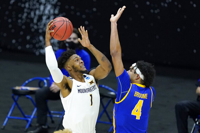 West Virginia's Derek Culver (1) shoots against Morehead State's Johni Broome (4) during the first half of a college basketball game in the first round of the NCAA tournament at Lucas Oil Stadium Friday, March 19, 2021, in Indianapolis. (AP Photo/Mark Humphrey)