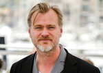 "FILE - In this May 12, 2018, file photo, director Christopher Nolan poses during a photo call at the 71st international film festival in Cannes, southern France. Warner Bros. announced late Thursday, June 25, that it is delaying the release of Nolan's sci-fi thriller ""Tenet"" from July 31 until Aug. 12, a date the studio says will give it more flexibility to get the film in theaters despite uncertainty caused by a surge in coronavirus cases in certain locales. (Photo by Arthur Mola/Invision/AP, File)"