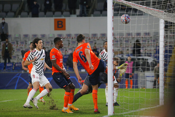 Basaksehir's Alexandru Epureanu, right, clears the ball during the Champions League group H soccer match between Istanbul Basaksehir and Manchester United at the Fatih Terim stadium in Istanbul, Wednesday, Nov. 4, 2020. (AP Photo)