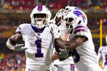 Buffalo Bills wide receiver Emmanuel Sanders (1) is congratulated by Tremaine Edmunds, right, after scoring during the second half of an NFL football game against the Kansas City Chiefs Sunday, Oct. 10, 2021, in Kansas City, Mo. (AP Photo/Charlie Riedel)
