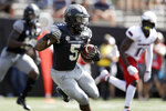 Vanderbilt running back Ke'Shawn Vaughn (5) carries the ball against Northern Illinois in the first half of an NCAA college football game Saturday, Sept. 28, 2019, in Nashville, Tenn. (AP Photo/Mark Humphrey)
