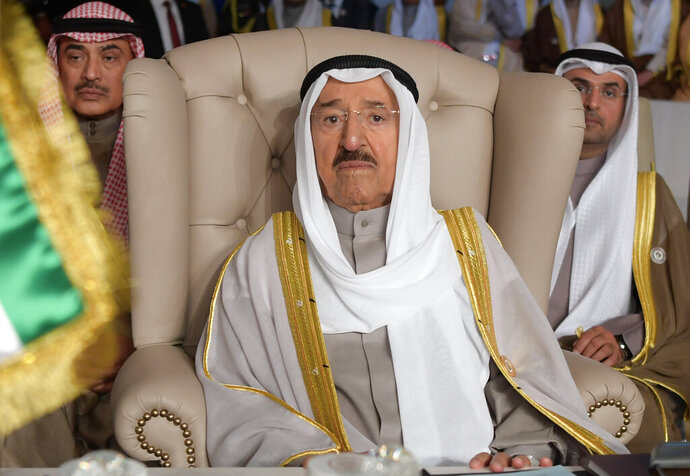 FILE - In this March 31, 2019 file photo, Kuwait's ruling emir, Sheikh Sabah Al Ahmad Al Sabah, attends the opening of the 30th Arab Summit, in Tunis, Tunisia. The White House said Friday that Trump is awarding the Legion of Merit to Kuwait's Sheikh Sabah Al Ahmad Al Sabah, who, along with Oman, has sought dialog to end a boycott that fellow Gulf Cooperation Council that's targeted Qatar since June 2017. The emir's eldest son was to accept the award on behalf of his father in a private ceremony. (Fethi Belaid/Pool Photo via AP, File)