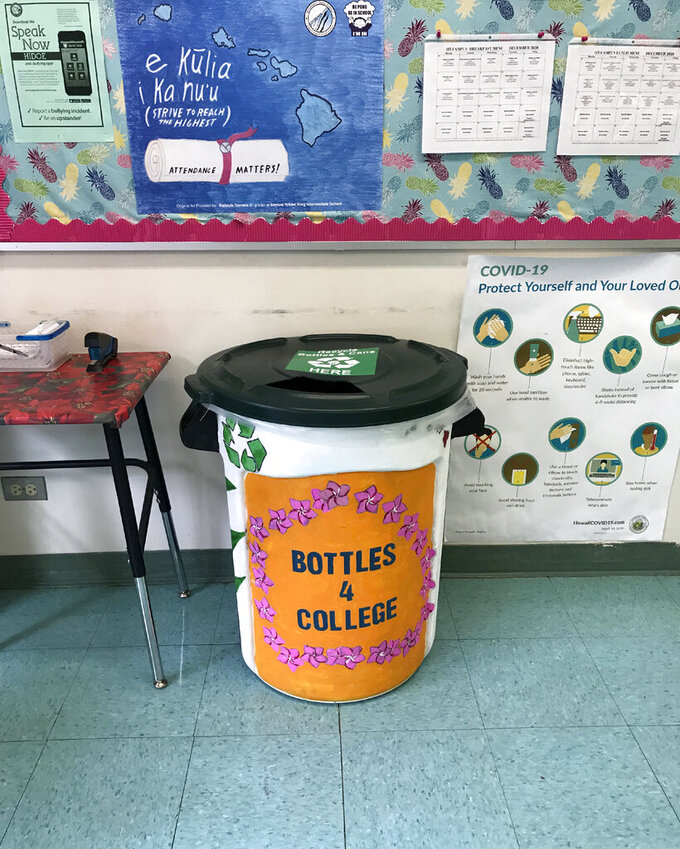 In this Oct. 10, 2020, photo provided by Maria Price, a student-painted drop-off bin for Genshu Price's fundraiser, Bottles4College, is stationed in the office at S.W. King Intermediate School in Kāne'ohe, Hawaii. Price started Bottles4College three years ago to raise money for his own tuition but has since expanded the recycling project to benefit other students. (Bottles4College via AP)