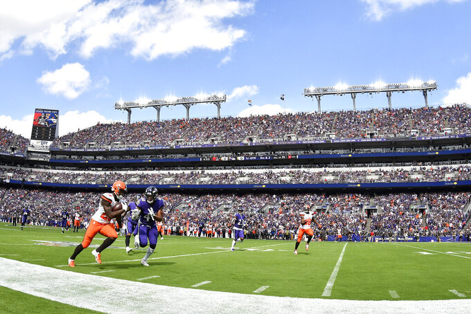 Cleveland Browns running back Dontrell Hilliard, left, runs with the ball as Baltimore Ravens inside linebacker Kenny Young prepares to push him out of bounds during the first half of an NFL football game Sunday, Sept. 29, 2019, in Baltimore. (AP Photo/Brien Aho)