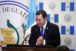 Guatemalan President Jimmy Morales speaks during the dedication ceremony of the embassy of Guatemala in Jerusalem, Wednesday, May 16, 2018. Guatemala has opened its new embassy in Jerusalem, becoming the second country to do so after the United States. (Ronen Zvulun/Pool Photo via AP)