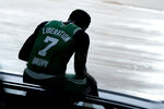 Boston Celtics' Jaylen Brown sits on a side board after committing a foul against the Toronto Raptors during the first half of an NBA basketball game Friday, Aug. 7, 2020 in Lake Buena Vista, Fla. (AP Photo/Ashley Landis, Pool)