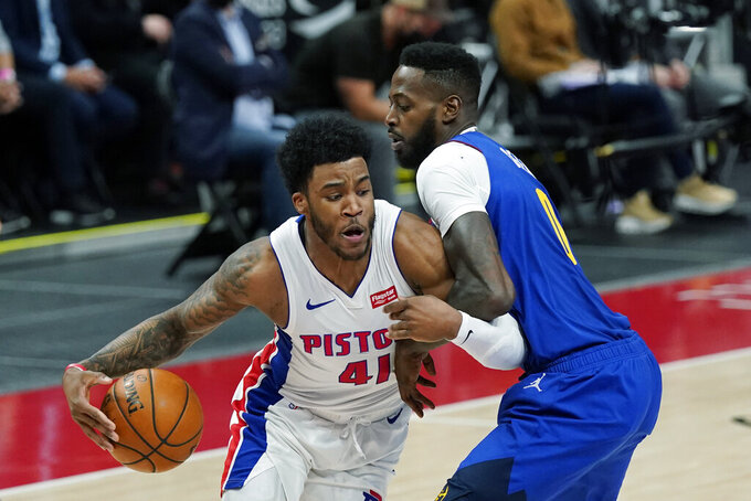 Detroit Pistons forward Saddiq Bey (41) is defended by Denver Nuggets forward JaMychal Green during the second half of an NBA basketball game, Friday, May 14, 2021, in Detroit. (AP Photo/Carlos Osorio)