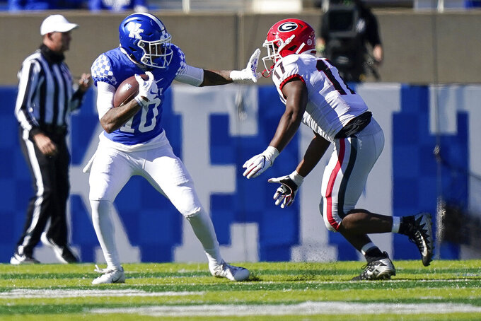Georgia linebacker Nakobe Dean (17) tackles Kentucky running back Asim Rose Jr. (10) during the second half of an NCAA college football game, Saturday, Oct. 31, 2020, in Lexington, Ky. (AP Photo/Bryan Woolston)